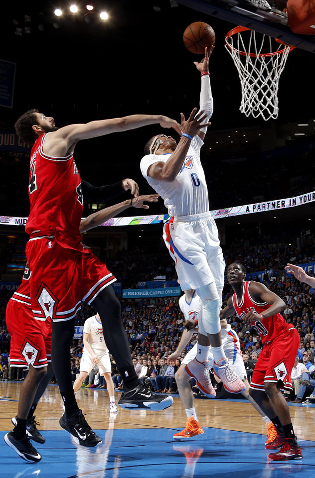 Photo - Oklahoma City's Russell Westbrook (0) shoots over Chicago's Nikola Mirotic (44) during the NBA game between the Oklahoma City Thunder and the Chicago Bulls at Chesapeake Energy Arena in Oklahoma City, Sunday, March  15, 2015. Photo by Sarah Phipps, The Oklahoman