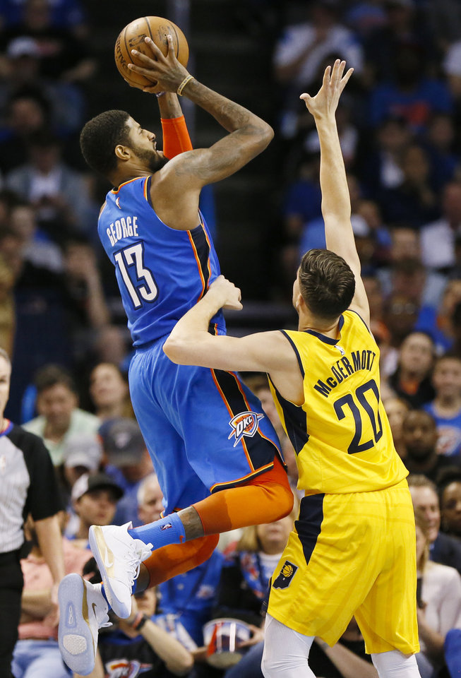Photo - Oklahoma City's Paul George (13) shoots over Indiana's Doug McDermott (20) in the third quarter during an NBA basketball game between the Indiana Pacers and the Oklahoma City Thunder at Chesapeake Energy Arena in Oklahoma City, Wednesday, March 27, 2019. Oklahoma City won 107-99. Photo by Nate Billings, The Oklahoman