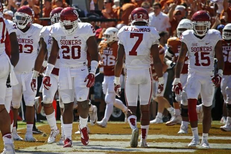 Photo - Sooners Jordan Wade (93), Frank Shannon (20), Jordan Thomas (7) and Zack Sanchez (15) trudge back to the sideline after a Texas touchdown on Oct. 10. (Photo by Bryan Terry) , The Oklahoman | Imported: Sat. Oct 10, 2015