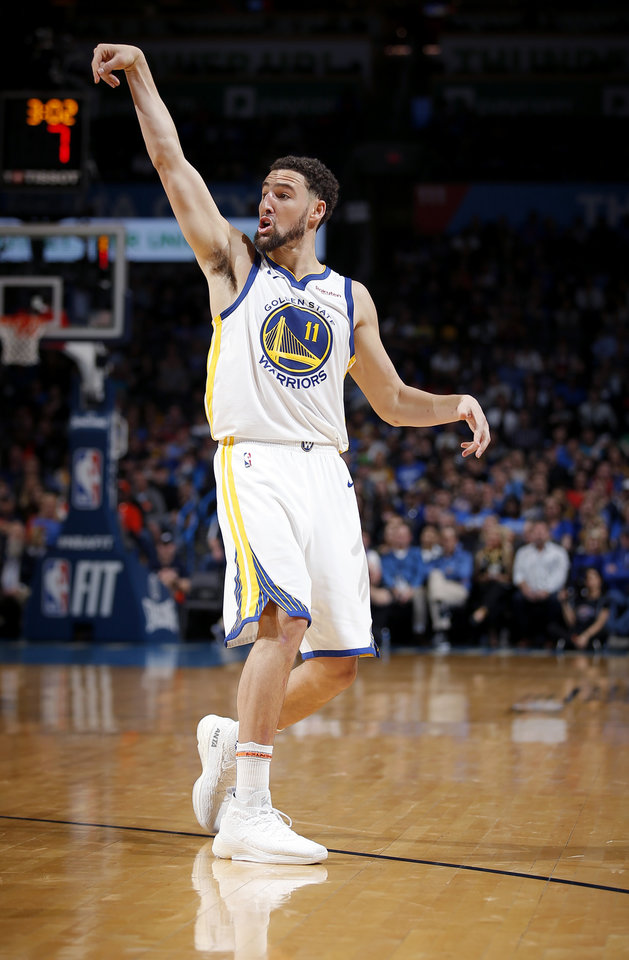 Photo - Golden State's Klay Thompson (11) watches a shot fall in during the NBA basketball game between the Oklahoma City Thunder and the Golden State Warriors at Chesapeake Energy Arena,  Saturday, March 16, 2019. Photo by Sarah Phipps, The Oklahoman