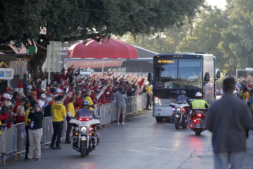 Photo - The Oklahoma team arrives before the Red River Showdown college football game between the University of Oklahoma Sooners (OU) and the Texas Longhorns (UT) at Cotton Bowl Stadium in Dallas, Saturday, Oct. 12, 2019. [Bryan Terry/The Oklahoman]