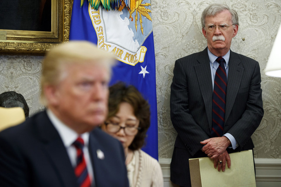 Photo -  In this May 22, 2018, file photo, U.S. President Donald Trump, left, meets with South Korean President Moon Jae-In in the Oval Office of the White House in Washington, as national security adviser John Bolton, right, watches. Trump says he fired national security adviser John Bolton, says they 'disagreed strongly' on many issues. [AP Photo/Evan Vucci, File]
