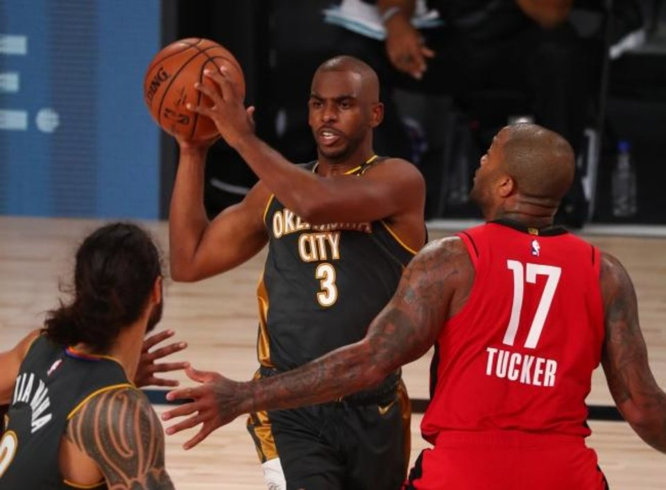 Photo -  Thunder guard Chris Paul (3) looks to pass the ball away from Rockets forward P.J. Tucker (17) during the fourth quarter Monday. [Kim Klement/USA TODAY Sports]