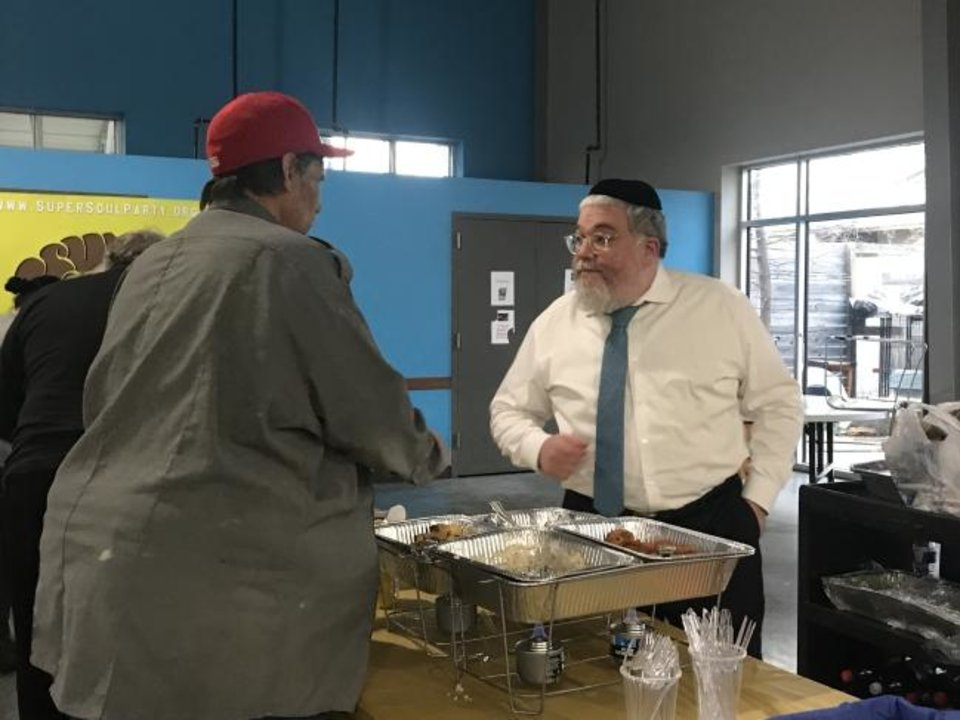 Photo -  Rabbi Ovadia Goldman, right, chats with an Oklahoma City Homeless Alliance WestTown staff member during the Super Soul Party on Feb. 2 at the Homeless Alliance's day shelter, 1724 NW 4. [Carla Hinton/The Oklahoman]