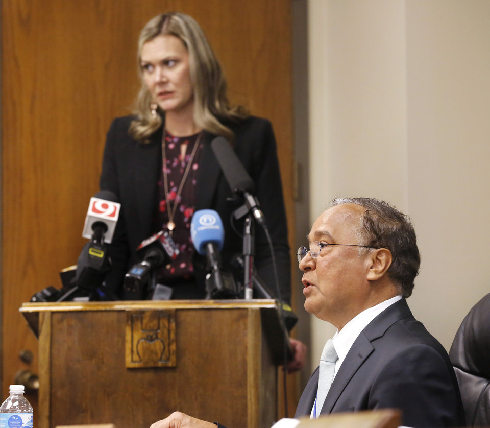 Photo - R. Murali Krishna, board member. Addressing the board is Julie Ezell, general counsel for the health department. The Oklahoma State Department of Health voted at their monthly meeting Tuesday morning, July 10, 2018, to ban sales of smokeable forms of medical marijuana and to require dispensaries to hire a pharmacist. The Board of Health voted on 75 pages of rules creating a rough framework for patients, physicians, caretakers and business owners interested in medical marijuana. The ban on sales of leaves and flowers for smoking and the requirement to hire a pharmacist weren't in the draft rules presented to the board, but were a priority of a coalition of medical groups. Julie Ezell, the Health Department's general counsel, presented the rules to a packed board room and to members of the public watching in an overflow room and online. She cautioned board members that the two new rules they added might not be allowed under the state question, inviting a court challenge. Photo by Jim Beckel, The Oklahoman