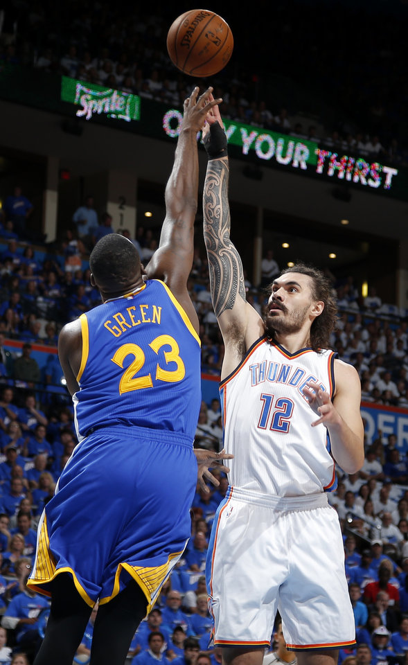 Photo - Oklahoma City's Steven Adams (12) shoots over Golden State's Draymond Green (23) during Game 3 of the Western Conference finals in the NBA playoffs between the Oklahoma City Thunder and the Golden State Warriors at Chesapeake Energy Arena in Oklahoma City, Sunday, May 22, 2016. Photo by Bryan Terry, The Oklahoman