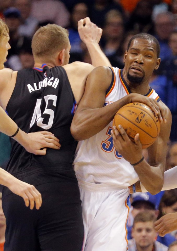Photo - Oklahoma City's Kevin Durant (35) collides with Los Angeles Clippers' Cole Aldrich (45) during the NBA basketball game between the Oklahoma City Thunder and the Los Angeles Clippers at Chesapeake Energy Arena on Wednesday, March 9, 2016, in Oklahoma City, Okla. Photo by Chris Landsberger, The Oklahoman