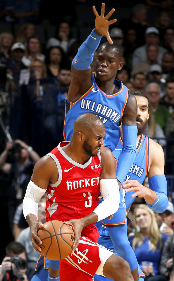 Photo - Oklahoma City's Dennis Schroder (17) guards Houston's Chris Paul (3) during an NBA basketball game between the Oklahoma City Thunder and the Houston Rockets at Chesapeake Energy Arena in Oklahoma City, Nov. 8, 2018. Photo by Bryan Terry, The Oklahoman