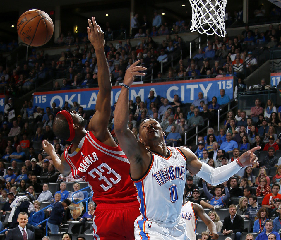Photo - Oklahoma City's Russell Westbrook (0) goes for the ball beside Houston's Corey Brewer (33) during an NBA basketball game between the Oklahoma City Thunder and the Houston Rockets at Chesapeake Energy Arena in Oklahoma City, Friday, Jan. 29, 2016. Photo by Bryan Terry, The Oklahoman