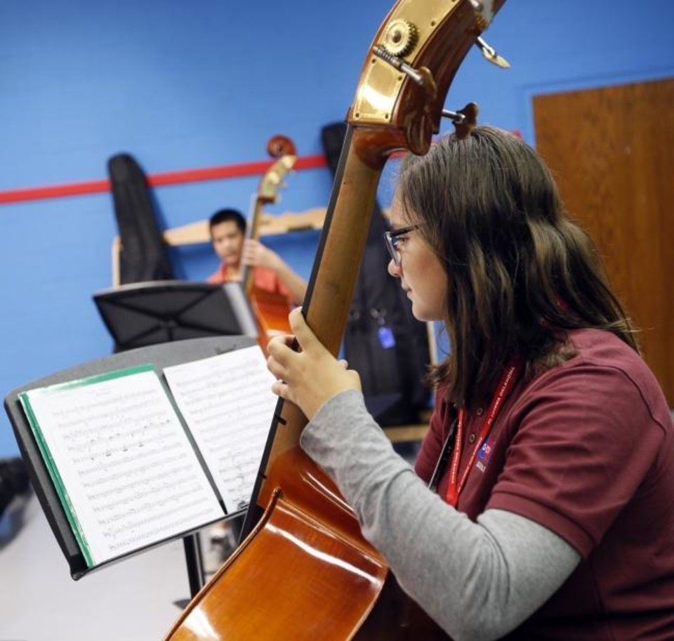 Photo -  Izzabella Truong-Richardson plays the bass during El Sistema Oklahoma at First Presbyterian Church, 1001 NW 25, in Oklahoma City, Friday, Aug. 17, 2018. El Sistema Oklahoma is a free after-school orchestral music program [Nate Billings/The Oklahoman Archives]