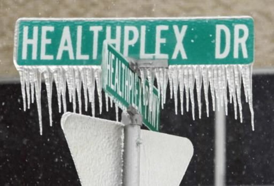 Photo - Ice coats a street sign after Thursday's winter storm on Friday, Jan. 29, 2010, in Norman, Okla. Photo by Steve Sisney