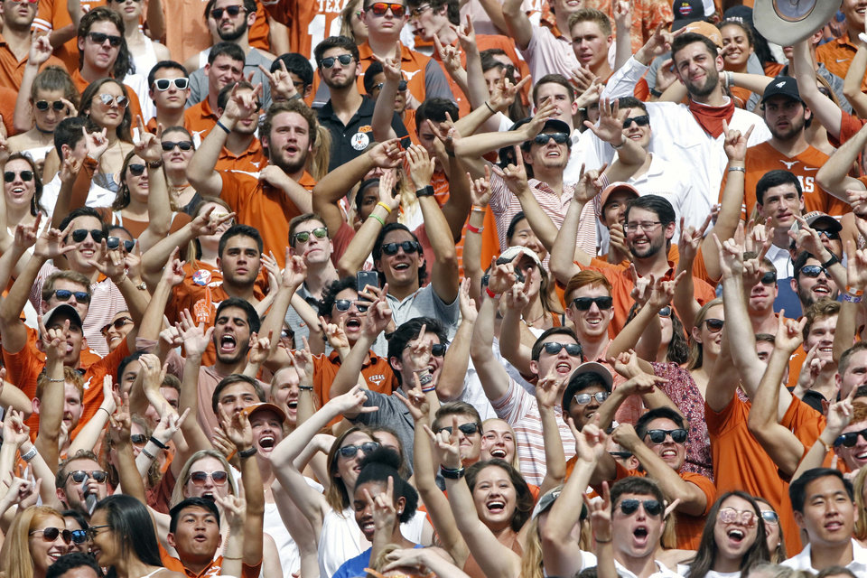 Photo - Texas fans celebrate a missed field goal by Oklahoma State kicker Matt Ammendola during the second half of an NCAA college football game, Saturday, Oct. 21, 2017, in Austin, Texas. Oklahoma State won 13-10 in overtime. (AP Photo/Michael Thomas)