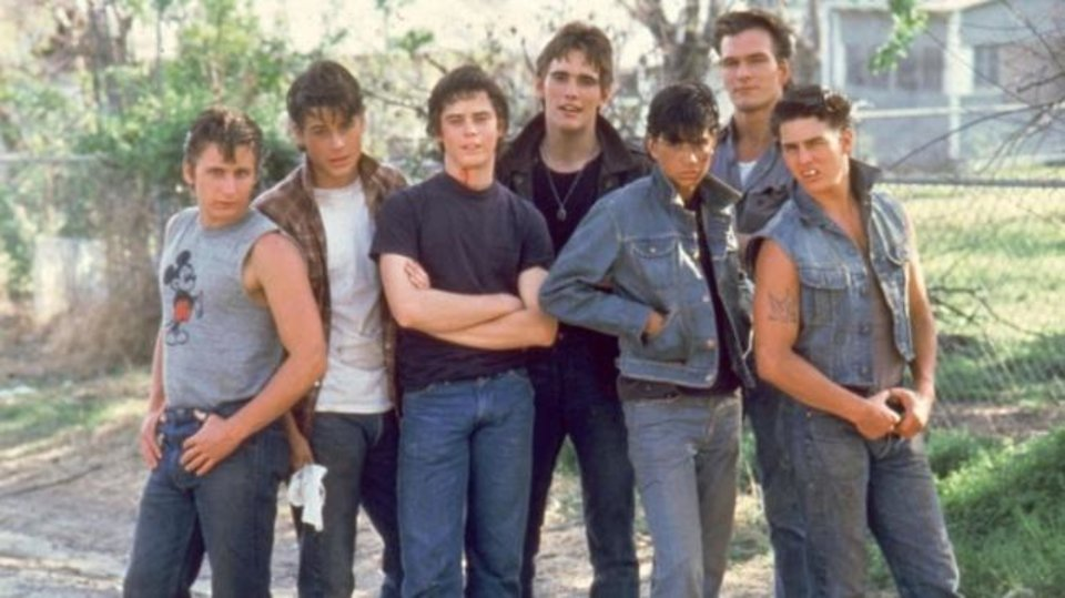 Photo -  From left, Emilio Estevez, Rob Lowe, C. Thomas Howell, Matt Dillon, Ralph Macchio,  Patrick Swayze and Tom Cruise star in