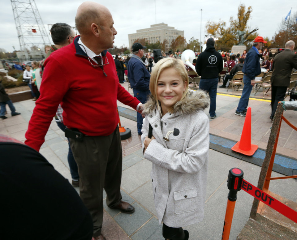 Photo - Darci Lynne Farmer leaves the stage after a microphone check before the state tree lighting ceremonies on Tuesday, Nov. 28, 2017 in Oklahoma City, Okla.  Photo by Steve Sisney, The Oklahoman