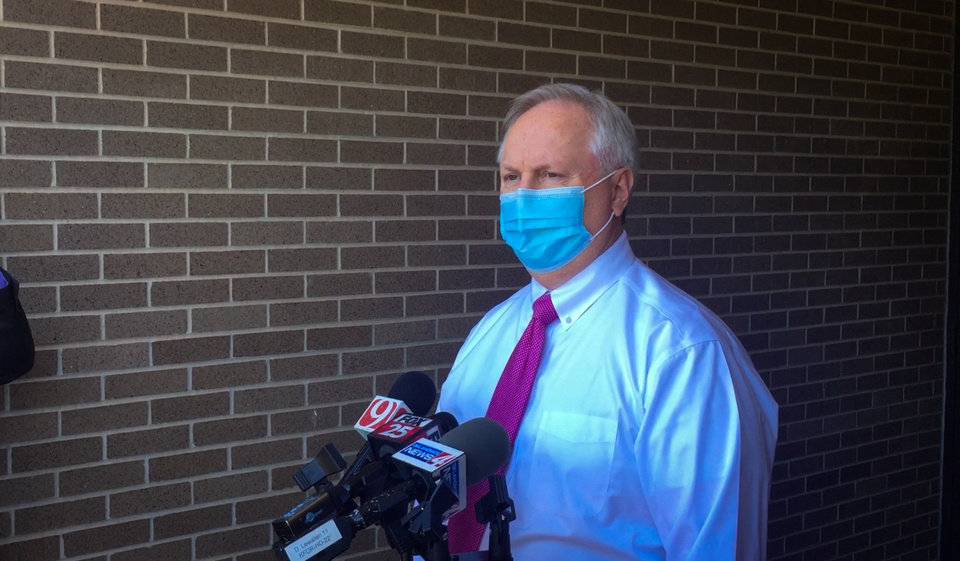 "Photo - Norman Police Chief Kevin Foster says the Norman Police Department is reviewing the actions of an officer who sent an image from the movie ""Django Unchained"" of Ku Klux Klan members wearing hoods and carrying torches in an email discussion of the wear and maintenance of face masks. Image by Tim Willert."
