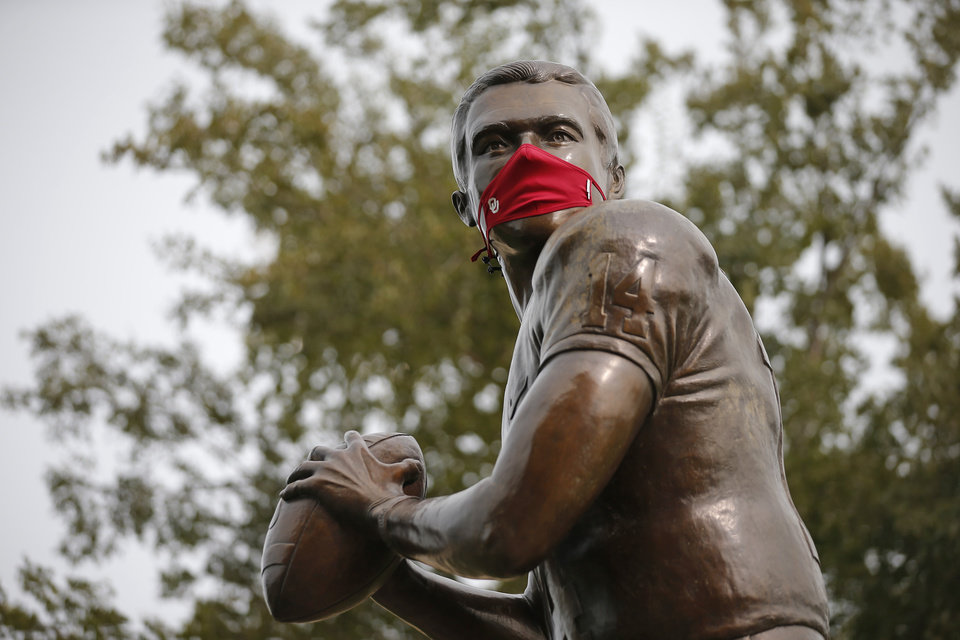 Photo - The Sam Bradford statue at Heisman Park is seen with a mask before a college football game between the University of Oklahoma Sooners (OU) and Missouri State in Norman, Okla., Saturday, Sept. 12, 2020. [Bryan Terry/The Oklahoman]