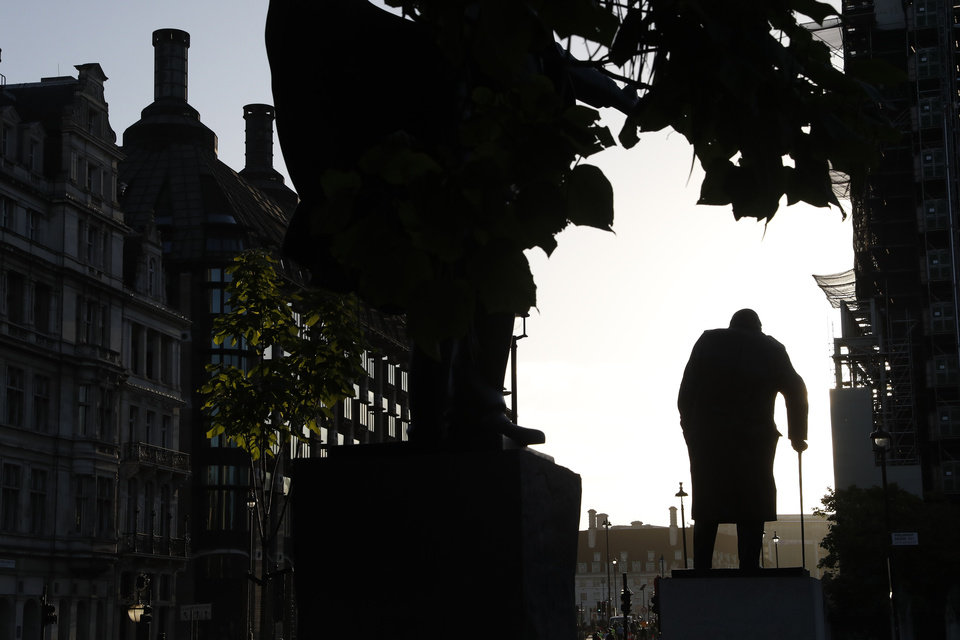 Photo -  The statue of former British Prime Minister Winston Churchill is silhouetted against the sky early morning in London, Thursday, Sept. 12, 2019. (AP Photo/Alastair Grant)