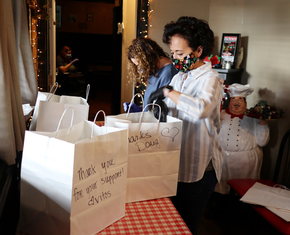 Photo - Owner Cathy Cummings sorts orders for pickup. Vito's Ristorante will continue to have carry out even after the dining room opens because of the limits in the number of customers allowed to dine in at once. Wednesday, May 13, 2020. [Doug Hoke/The Oklahoman]
