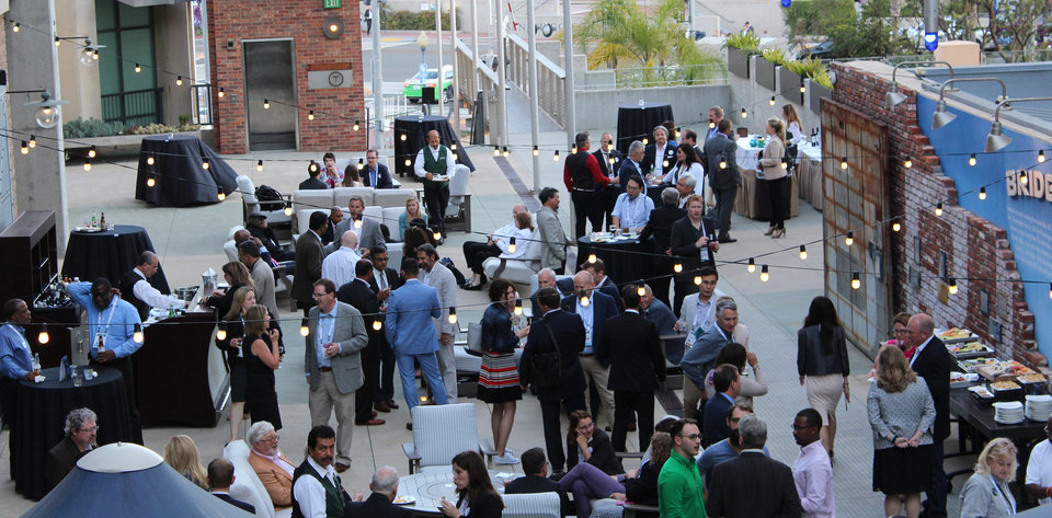 Photo -  A crowd gathers at Tuesday's OKBIO networking event held at the Hilton Gaslamp Hotel in San Diego.