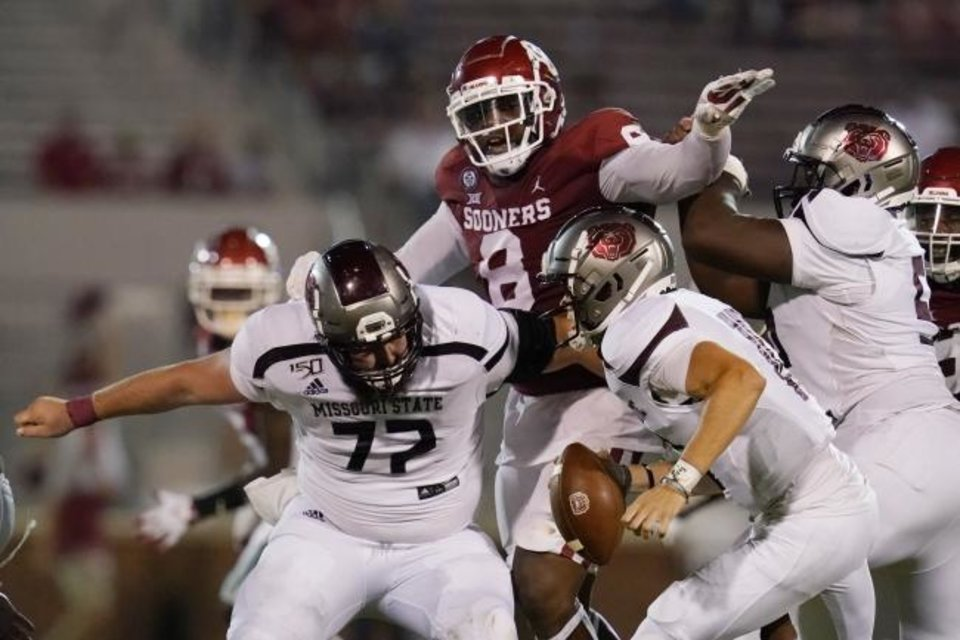 Photo -  OU defensive lineman Perrion Winfrey (8) attempts to get past Missouri State lineman Derek Kohler (72) to get to quarterback Jake Van Dyne (10) during the second half of the Sooners' season-opening win Sept. 12 in Norman. [AP Photo/Sue Ogrocki]