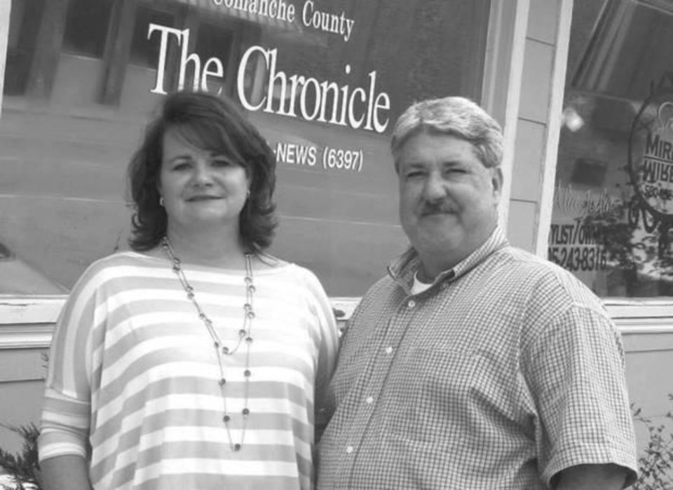 Photo - Tinker and John Hruby, pictured in front of the Comanche County Chronicle in Elgin, which they purchased in 2013. Photo provided by the Oklahoma Press Association.