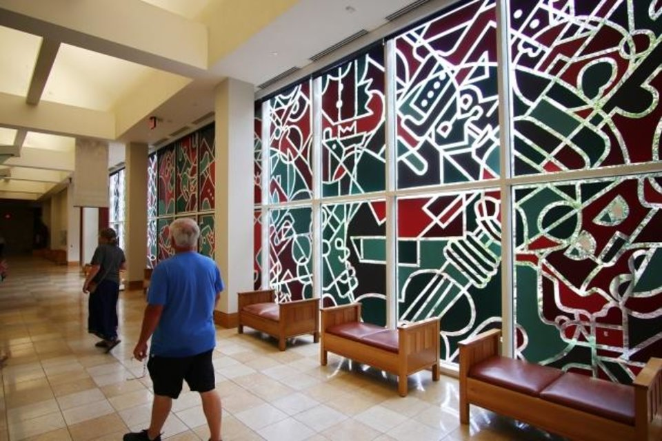 Photo -  Sunlight shines through John Salame's window murals on July 15 at the National Cowboy & Western Heritage Museum. [Doug Hoke/The Oklahoman Archives]