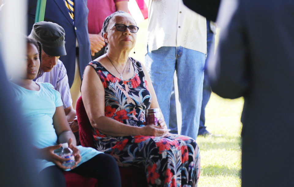 Photo - Alma Lucas, granddaughter of Ulysses Grant Moore listens to Rev. Richard Mize, Trinity Presbyterian Church at the memorial for U.G. Moore, a WWI vet whose grave marker never make it to his grave at Trice Hill Cemetery, until 55 years after his death, Tuesday, July 16, 2019. [Doug Hoke/The Oklahoman]