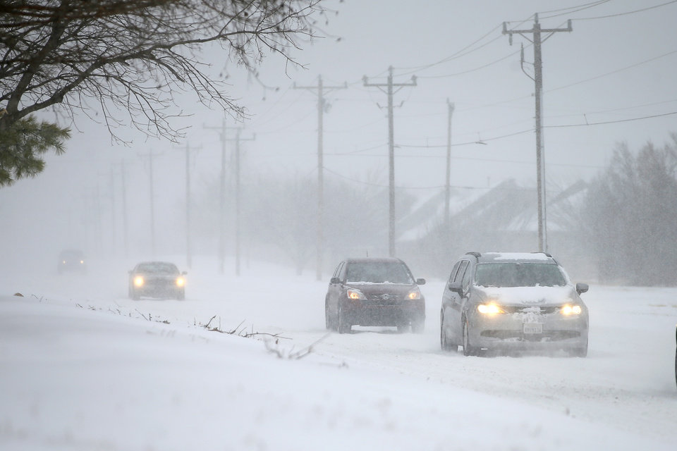 Photo - Vehicles travel east on NW 164 in northwest Oklahoma City during a winter storm, Sunday, Feb. 14, 2021. [Bryan Terry/The Oklahoman]