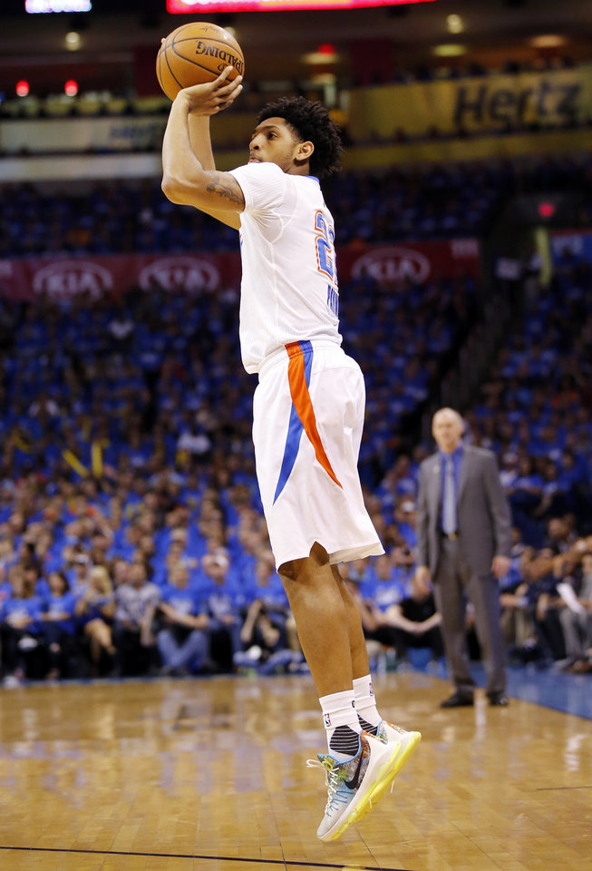 Photo - Oklahoma City's Cameron Payne (22) shoots during Game 5 of the first round series between the Oklahoma City Thunder and the Dallas Mavericks in the NBA playoffs at Chesapeake Energy Arena in Oklahoma City, Monday, April 25, 2016. Photo by Nate Billings, The Oklahoman