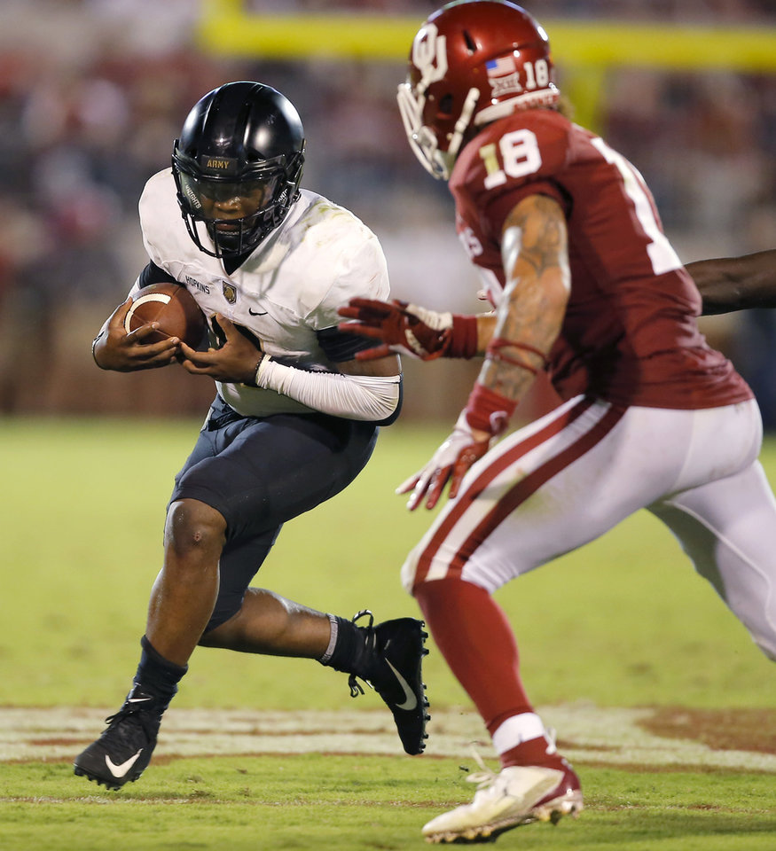 Photo - Army's Kelvin Hopkins Jr. (8) carries the ball during a college football game between the University of Oklahoma Sooners (OU) and the Army Black Knights at Gaylord Family-Oklahoma Memorial Stadium in Norman, Okla., Saturday, Sept. 22, 2018. Photo by Bryan Terry, The Oklahoman