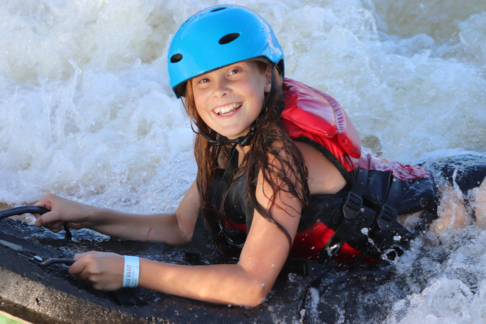 Photo -  An unidentified girl enjoys the rapids at Riversport OKC. [Provided by Riversport OKC]