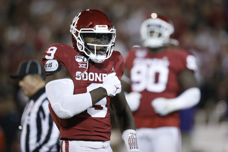 Photo - FILE - In this Saturday, Nov. 23, 2019 file photo, Oklahoma linebacker Kenneth Murray (9) celebrates a tackle during an NCAA college football game against TCU in Norman, Okla. Major improvements on defense have pushed Oklahoma and Baylor into the Big 12 championship game. Oklahoma led the Big 12 in total defense during conference play after finishing last a season ago. Baylor led the Big 12 in scoring defense and ranked third in total defense in league play a year after finishing seventh in total defense and eighth in scoring defense.(AP Photo/Sue Ogrocki, File)