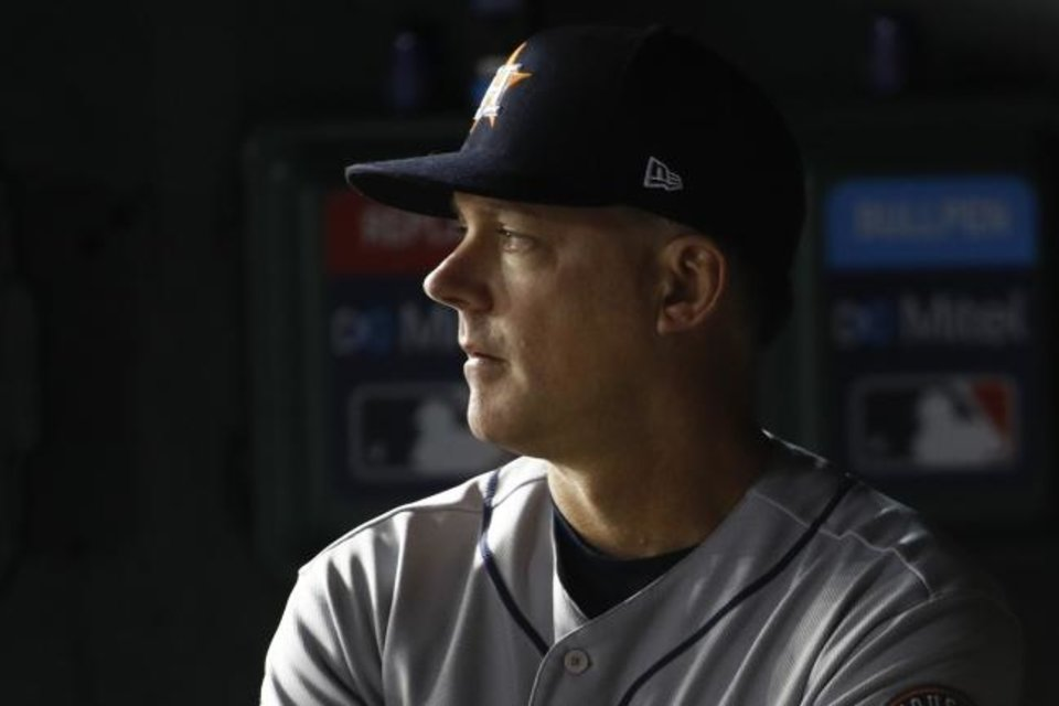Photo -  Houston Astros manager AJ Hinch watches during the second inning of Game 5 of the baseball World Series against the Washington Nationals Sunday, Oct. 27, 2019, in Washington. (AP Photo/Patrick Semansky)