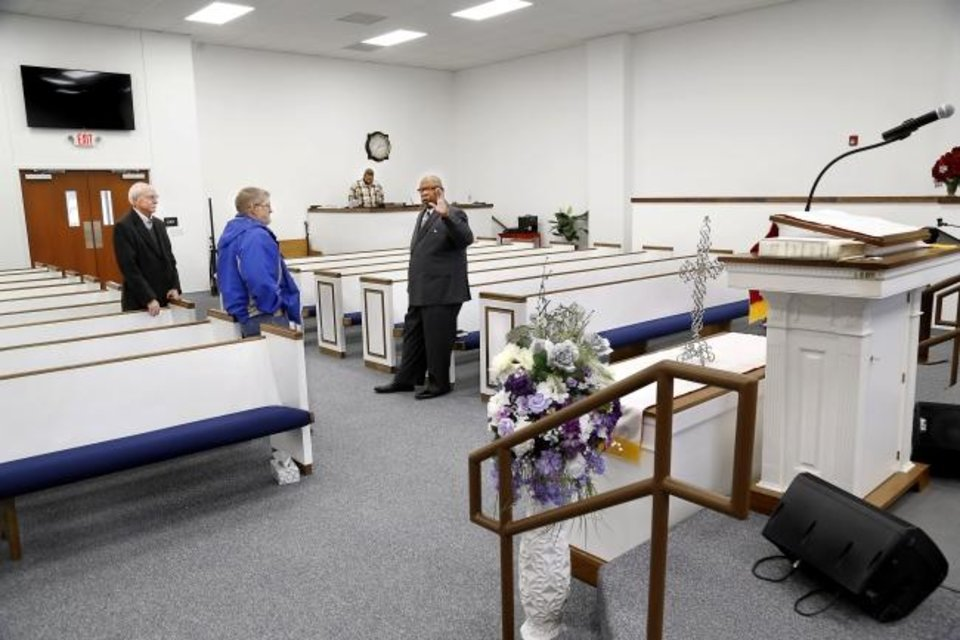 Photo -  Holy Temple Baptist Church's Pastor Frank McClarty, far right, is shown in the new sanctuary talking to Pat Renshaw, background left, and Eddie Cox on March 12.  Both men work for the company responsible for construction of McClarty's new building. [Jim Beckel/The Oklahoman]