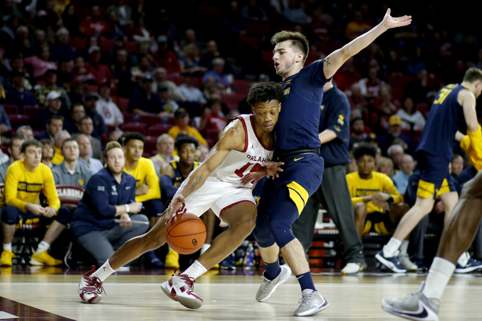 Photo - Oklahoma's Alondes Williams (15) tries to get past West Virginia's Jordan McCabe (5) during an NCAA mens college basketball game between the University of Oklahoma Sooners (OU) and the West Virginia Mountaineers at the Lloyd Noble Center in Norman, Okla.,Saturday, Feb. 8, 2020. Oklahoma won 69-59. [Bryan Terry/The Oklahoman]