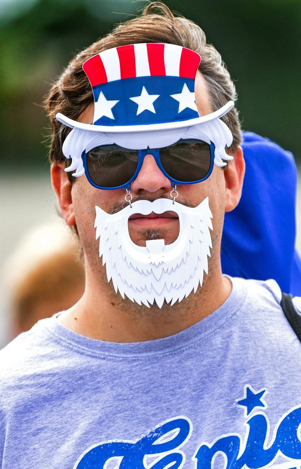 Photo - Stephen Ketola wears his 'Uncle Sam' mask as he finds a spot to watch the Bethany Freedom Festival parade in Bethany, Okla. on Thursday, July 4, 2019.    [Chris Landsberger/The Oklahoman]