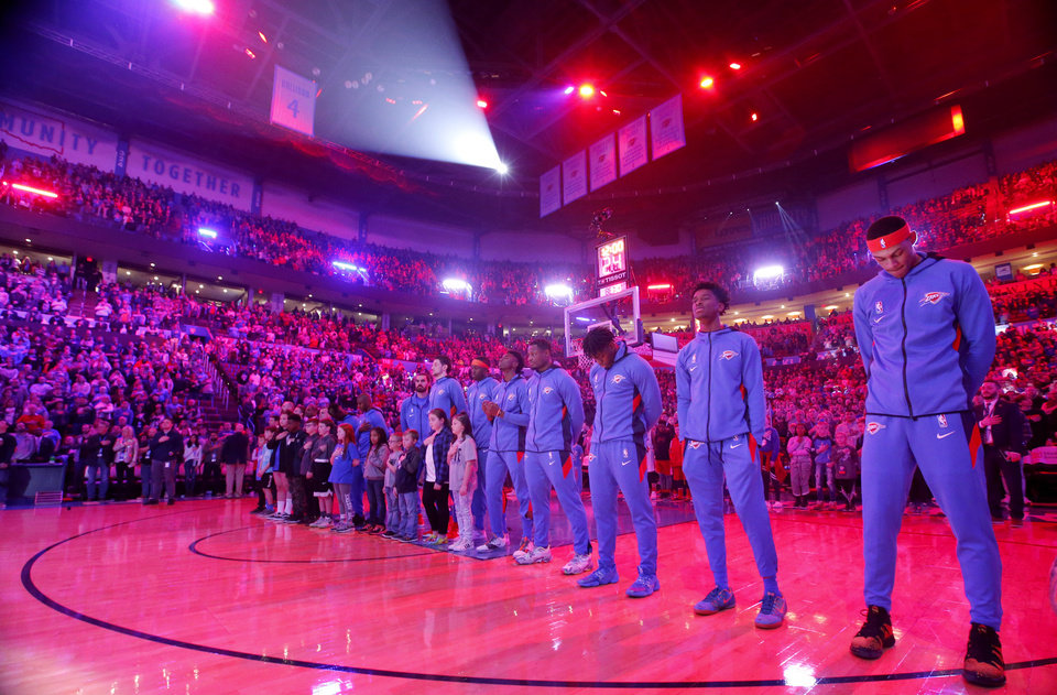 Photo - Oklahoma City stands for the prayer before the NBA basketball game between the Oklahoma City Thunder and the Portland Trail Blazers at the Chesapeake Energy Arena in Oklahoma City, Saturday, Jan. 18, 2020.  [Sarah Phipps/The Oklahoman]