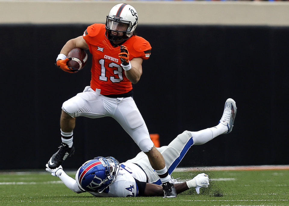 Photo - Oklahoma State's David Glidden (13) gets by Kansas' Bazie Bates IV (24) during a college football game between the Oklahoma State University Cowboys (OSU) and the Kansas Jayhawks (KU) at Boone Pickens Stadium in Stillwater, Okla., Saturday, Oct. 24, 2015. Photo by Sarah Phipps, The Oklahoman