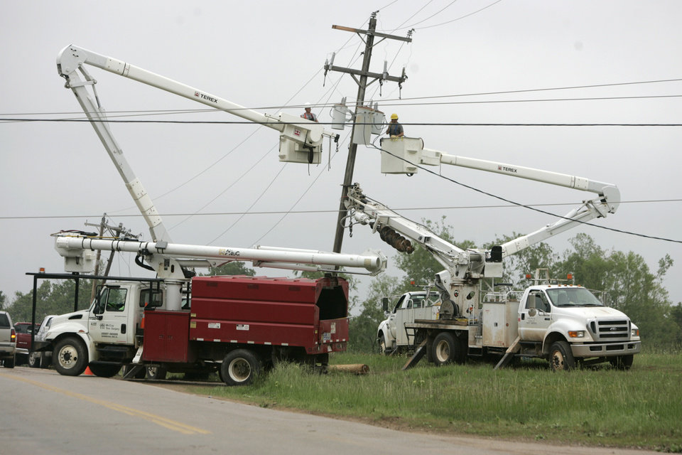 Photo - Lineman work to restore power 156th Ave. and Little Axe Dr. in Little Axe, Oklahoma May 11 , 2010. Photo by Steve Gooch, The Oklahoman