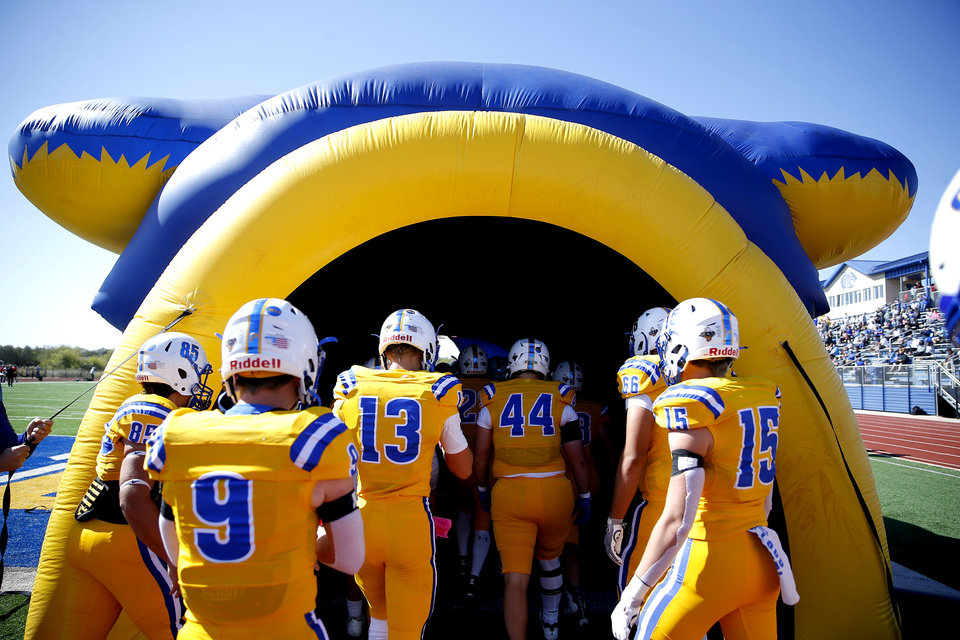 Photo - Piedmont prepares to run onto the field during the high school football game between Piedmont and Carl Albert at Piedmont High School in Piedmont, Oka., Saturday, Oct. 17, 2020. Photo by Sarah Phipps, The Oklahoman
