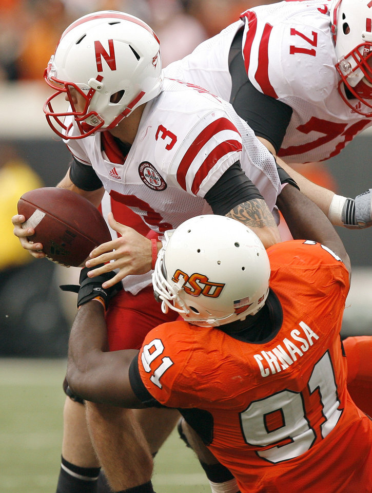 Photo - OSU's Ugo Chinasa sacks Nebraska's Taylor Martinez  during the college football game between the Oklahoma State Cowboys (OSU) and the Nebraska Huskers (NU) at Boone Pickens Stadium in Stillwater, Okla., Saturday, Oct. 23, 2010. Photo by Sarah Phipps, The Oklahoman