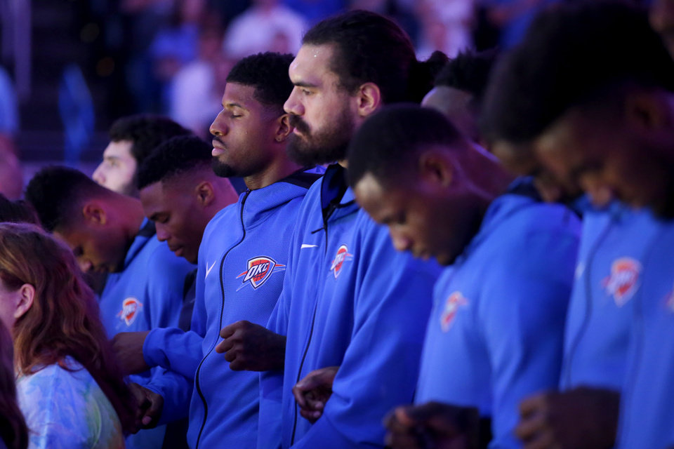 Photo - Oklahoma City's Russell Westbrook, Paul George and Steven Adams stand during the national anthem before an NBA basketball game between the Oklahoma City Thunder and the Sacramento Kings at Chesapeake Energy Arena in Oklahoma City, Sunday, Oct. 21, 2018. Photo by Bryan Terry, The Oklahoman
