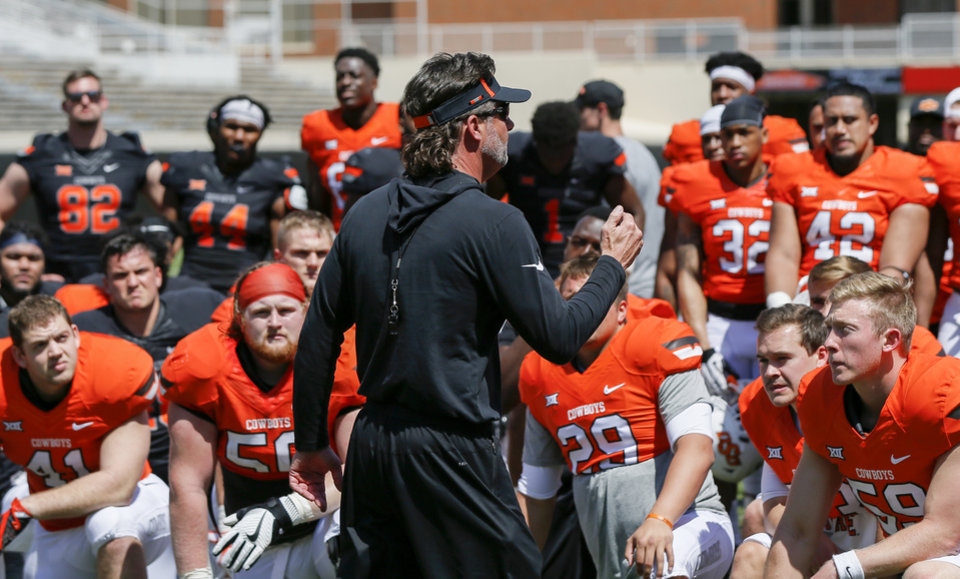 Photo - OSU head coach Mike Gundy talks to his team after the spring football game for the Oklahoma State Cowboys at Boone Pickens Stadium in Stillwater, Okla., Saturday, April 28, 2018. Photo by Nate Billings, The Oklahoman