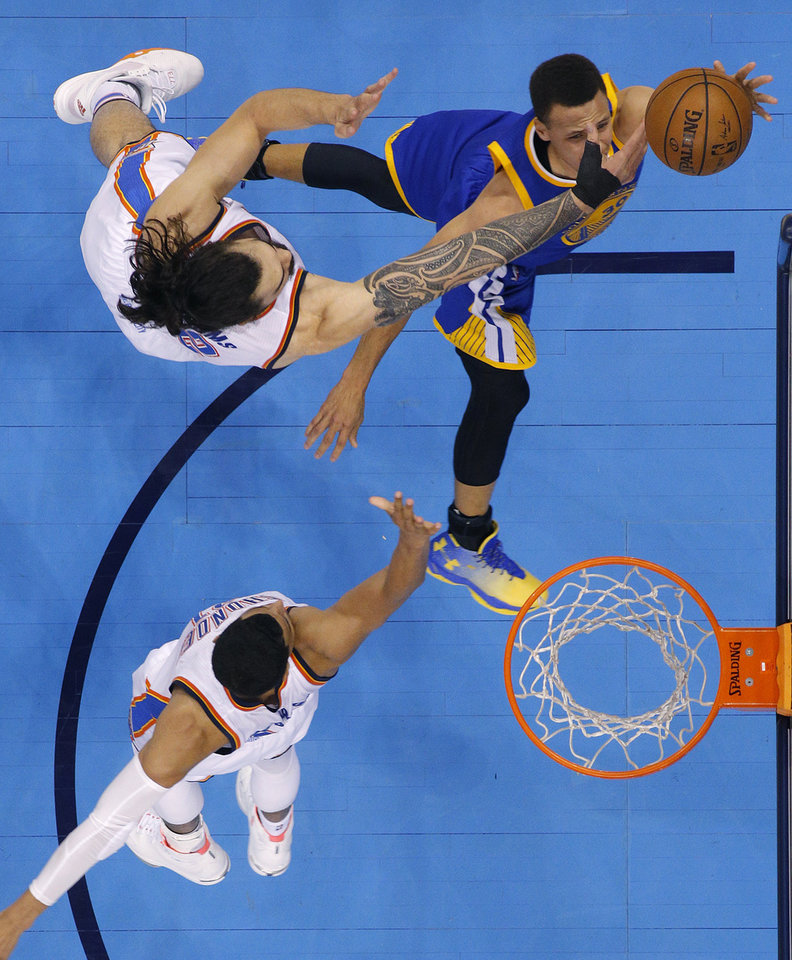 Photo - Oklahoma City's Steven Adams (12) defends Golden State's Stephen Curry (30) during Game 3 of the Western Conference finals in the NBA playoffs between the Oklahoma City Thunder and the Golden State Warriors at Chesapeake Energy Arena in Oklahoma City, Sunday, May 22, 2016. Oklahoma City won 133-105. Photo by Bryan Terry, The Oklahoman