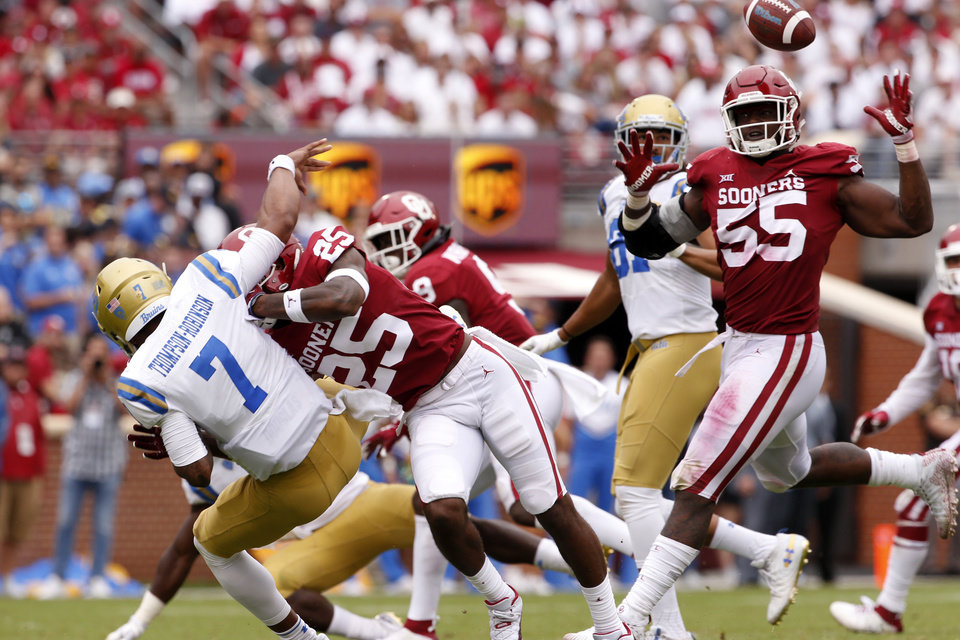 Photo - Oklahoma's Justin Broiles (25) breaks up a pass by UCLA's Dorian Thompson-Robinson (7) during the second half of a college football game where the University of Oklahoma Sooners (OU) defeated the UCLA Bruins 49-21 at Gaylord Family-Oklahoma Memorial Stadium in Norman, Okla., on Saturday, Sept. 8, 2018. Photo by Steve Sisney, The Oklahoman