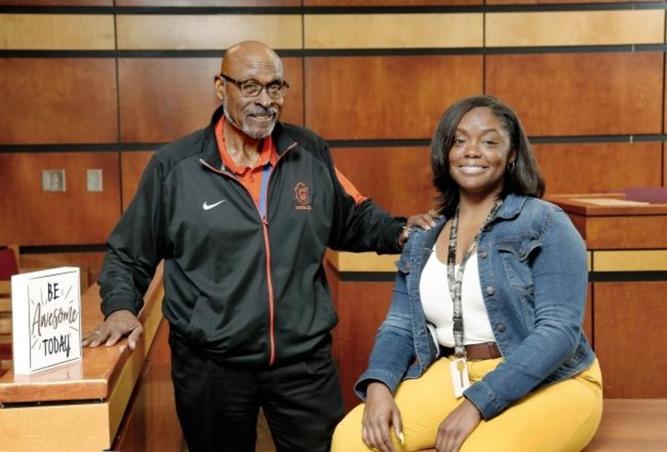 Photo -  Robert and Mauri Hubbard, father-daughter teachers, are shown in her classroom at Douglass High School where they each taught last school year and  where they plan to return when the new school season begins in August.  [Jim Beckel/The Oklahoman]