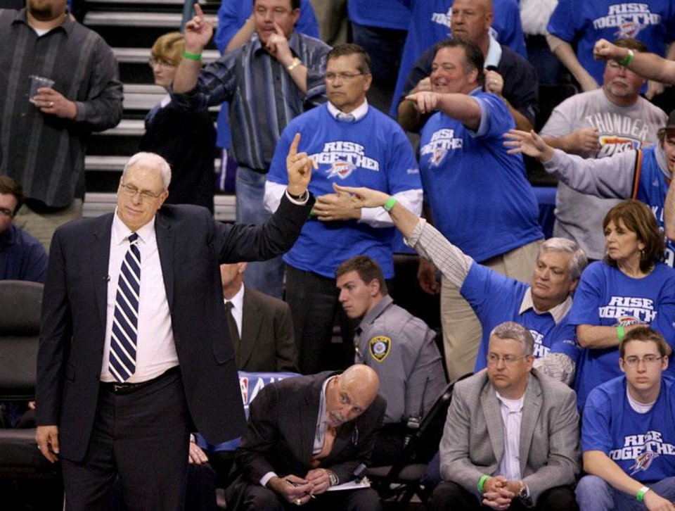 Photo -  Laker coach Phil Jackson argues a call during the basketball game between the Los Angeles Lakers and the Oklahoma City Thunder in the first round of the NBA playoffs at the Ford Center in Oklahoma City, Thursday, April 22, 2010. Photo by Bryan Terry, The Oklahoman