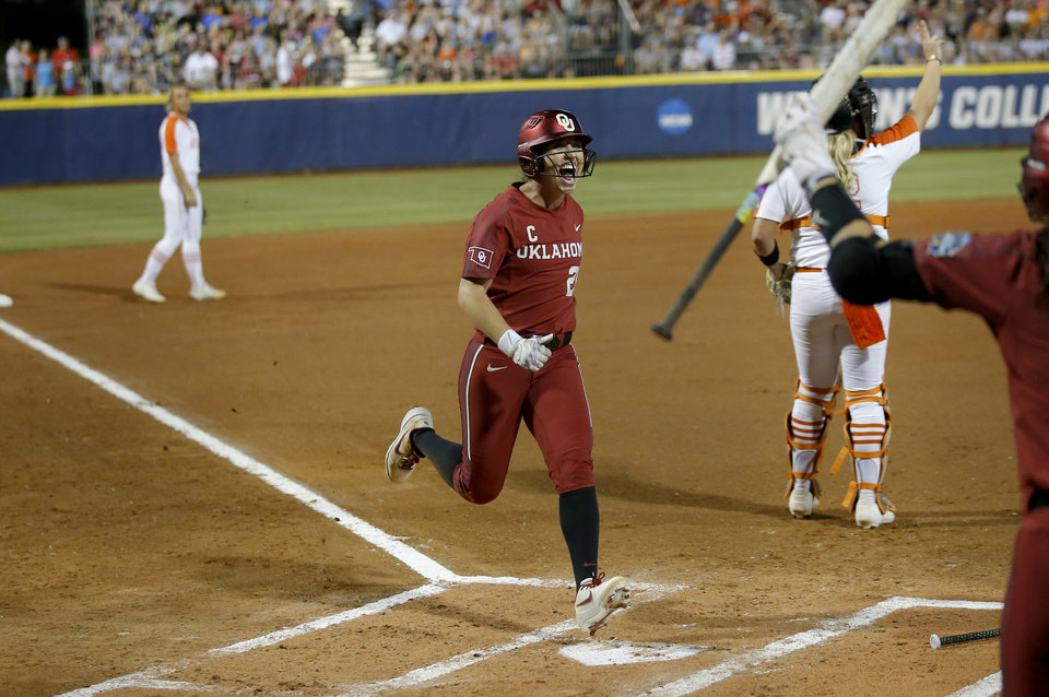 Photo - Oklahoma's Caleigh Clifton (20) celebrates a run in the first inning during a Women's College World Series between Oklahoma State (OSU) and Oklahoma at USA Softball Hall of Fame Stadium in Oklahoma City,  Friday, May 31, 2019.  [Sarah Phipps/The Oklahoman]