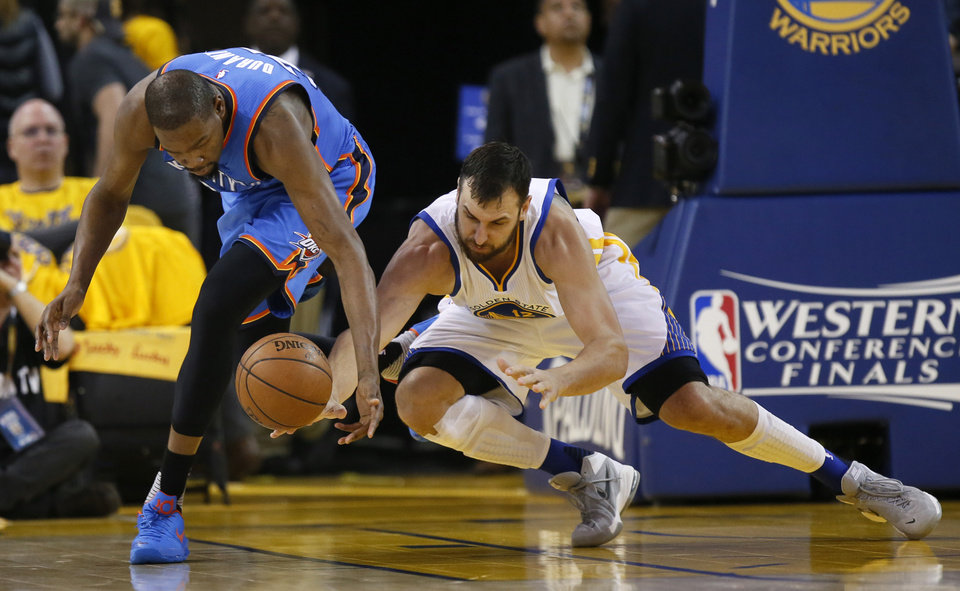 Photo - Oklahoma City's Kevin Durant (35) takes the ball away from Golden State's Andrew Bogut (12) during Game 2 of the Western Conference finals in the NBA playoffs between the Oklahoma City Thunder and the Golden State Warriors at Oracle Arena in Oakland, Calif., Wednesday, May 18, 2016. Photo by Nate Billings, The Oklahoman