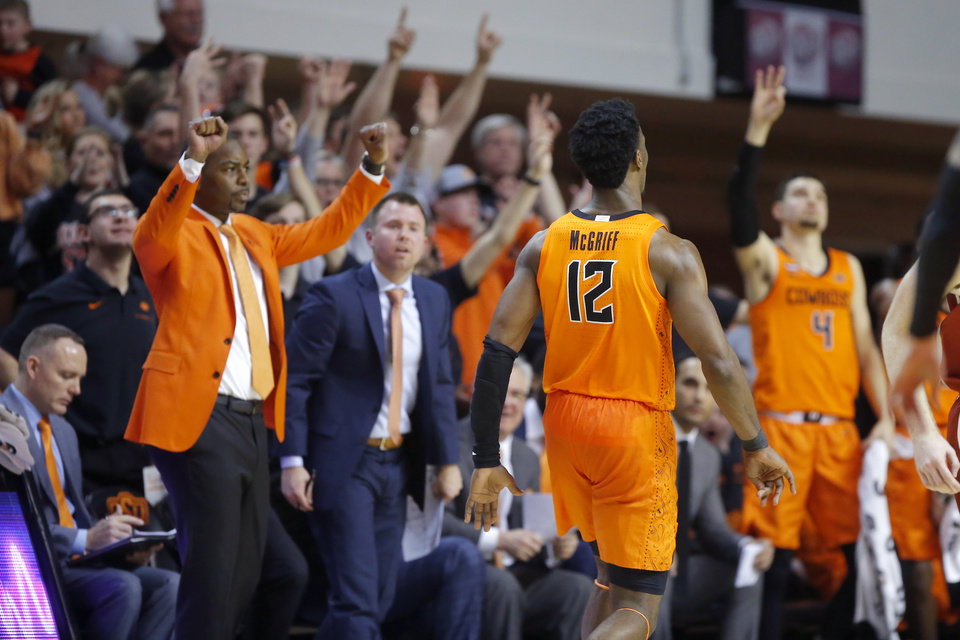 Photo - The Oklahoma State bench and fans celebrate a basket by Oklahoma State's Cameron McGriff (12) during an NCAA men's Bedlam basketball game between the Oklahoma State University Cowboys (OSU) and the University of Oklahoma Sooners (OU) at Gallagher-Iba Arena in Stillwater, Okla., Saturday, Feb. 22, 2020. Oklahoma State won 83-66. [Bryan Terry/The Oklahoman]